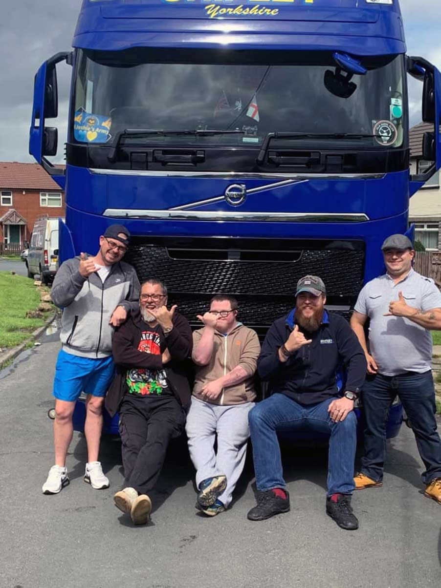 Community group in front of haulage vehicle